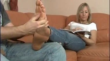 Mature lady foot rubbing tickling
