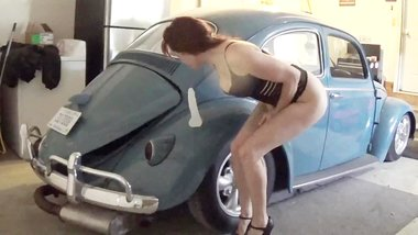 Sexy tatted chick fucks herself on antique car