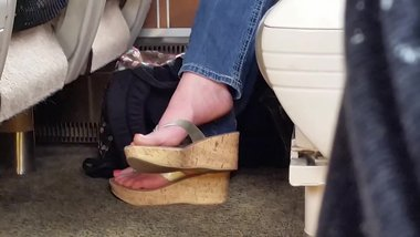 Sexy feet shoeplay, dangling wedges on train