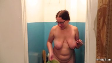 mature milf with big natural tits, urinate naked in a public toilet
