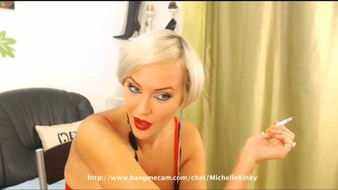 Short-haired blonde MILF smoking a cigarette on cam