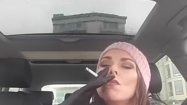 Milf smoking with leather gloves in her car