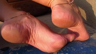 Sexy MILF's high arches soles feet close-up
